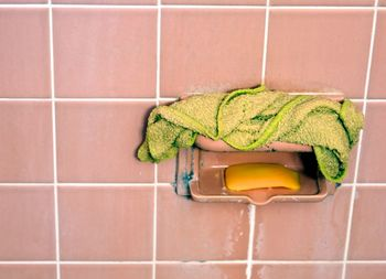 One of the different ways to use dryer sheets is using them to remove soap scum in a shower.