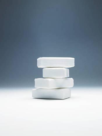 Four white bars of soap