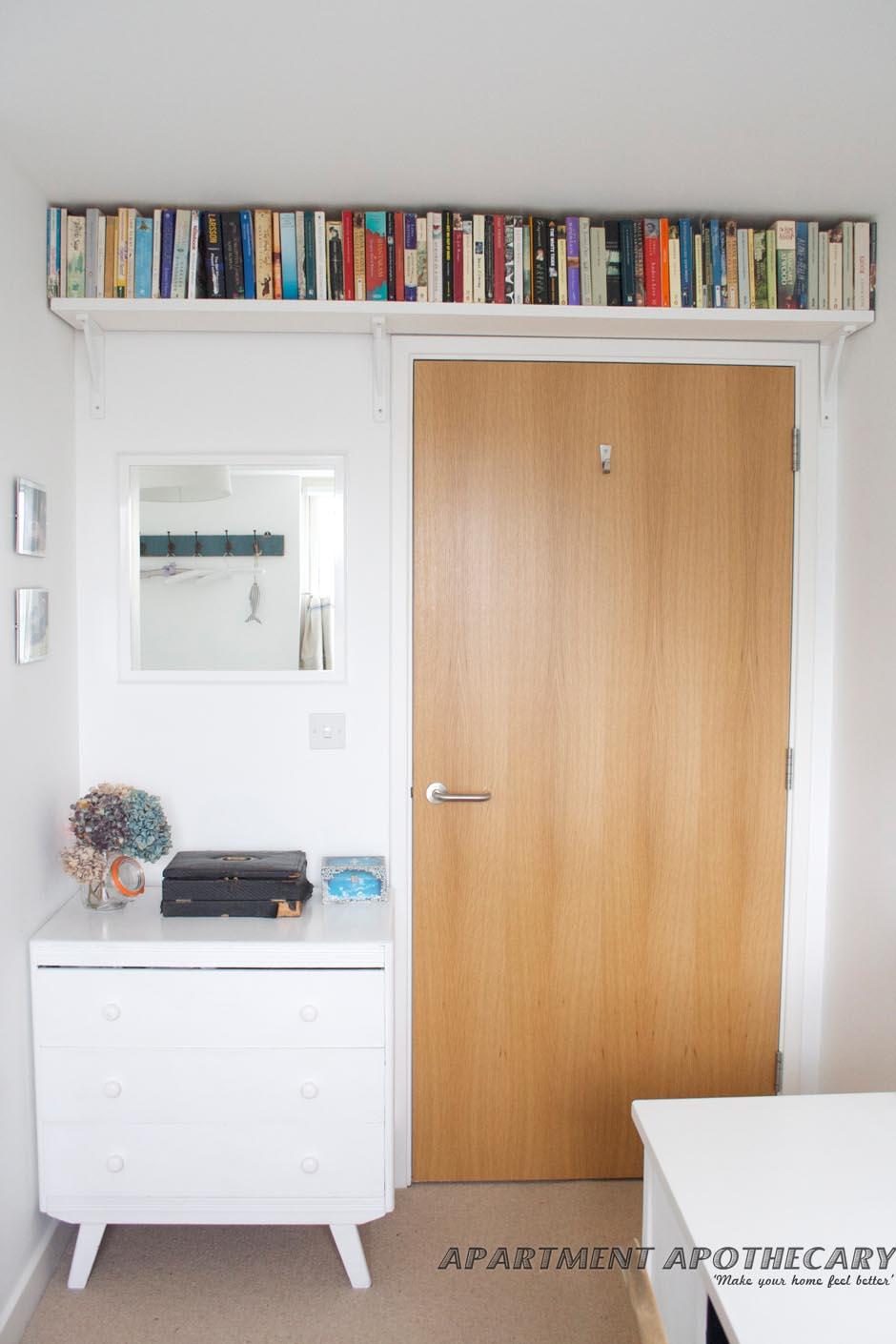 Space above door bookshelf decor