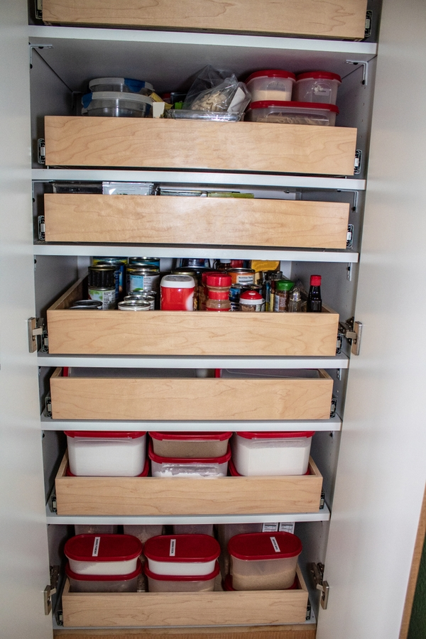 You may have a kitchen pantry design that is walk-in. Or your pantry space may be a wall of kitchen cabinets. If you're really lucky you may even have a butler's pantry. Whatever you've got, to get the most out of the space you need the best kitchen pantry design ideas out there. Pull out shelves will be the best feature of your pantry!
