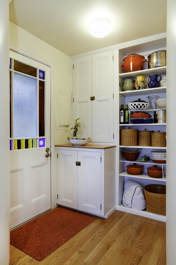 You may have a kitchen pantry design that is walk-in. Or your pantry space may be a wall of kitchen cabinets. If you're really lucky you may even have a butler's pantry. Whatever you've got, to get the most out of the space you need the best kitchen pantry design ideas out there. We even have pantry designs for small spaces!