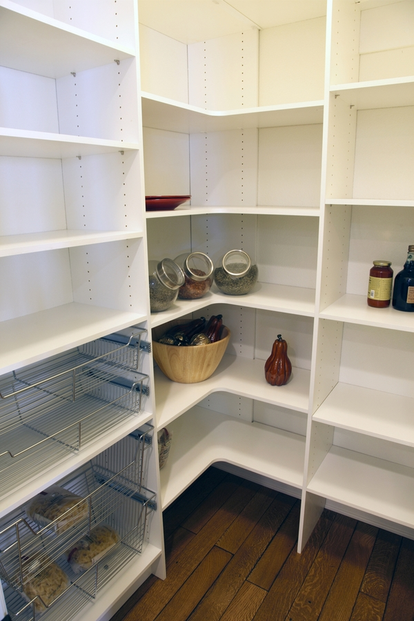You may have a kitchen pantry design that is walk-in. Or your pantry space may be a wall of kitchen cabinets. If you're really lucky you may even have a butler's pantry. Whatever you've got, to get the most out of the space you need the best kitchen pantry design ideas out there. Corner shelves really help you make the most of your pantry.