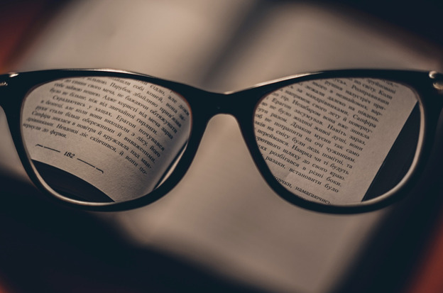 Eyeglasses used to read a book - cleaned by an eyeglass cleaner